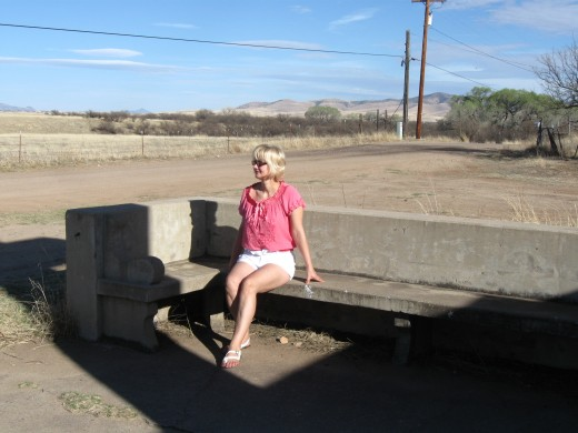 My wife relaxing on meditation bench in front of the Fray Marcos de Niza monument in southern Arizona.