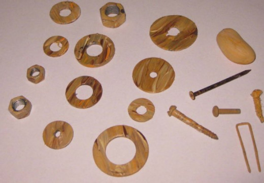 I found these washers, nails, and brads with my magnet then I painted them.