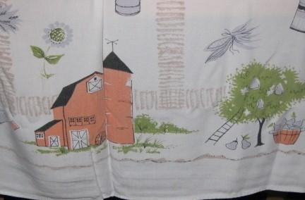 Vintage tablecloth with farm scene.