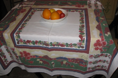 Vintage cotton tablecloth in Southwestern motif with cactus, mountains, man working, donkey, adobe house. Photos all taken by Peggy Hazelwood.