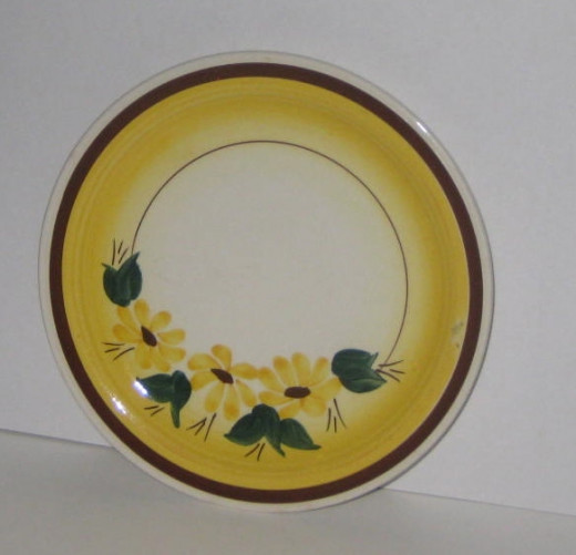 Lovely yellow, green, and brown China pattern. Wonder what its name is?