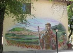 Mural of St. Francis of Assisi on a building at Franciscan Renewal Center.
