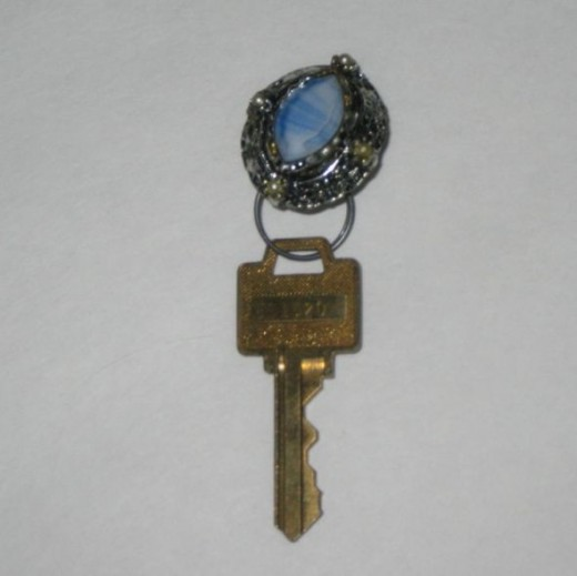 Large costume jewelry earring, now a key chain.