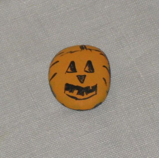 Jack o' Lantern painted on a rock.