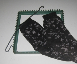 Just about everything you need to make potholders from old socks.