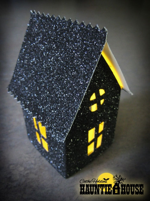 A wonderful but easy haunted house by Cathe at Just Something I Made. Visit her Web site for directions:  http://justsomethingimade.com/2011/08/haunted-house-luminary-party-treat-box-templates/ (clickable link in Link List below)