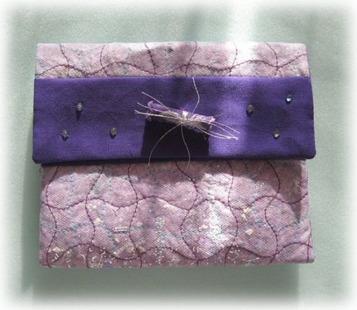 Dryer lint clutch available for sale by Etsy seller BrightIdeasStudio. See the link below to visit this listing.