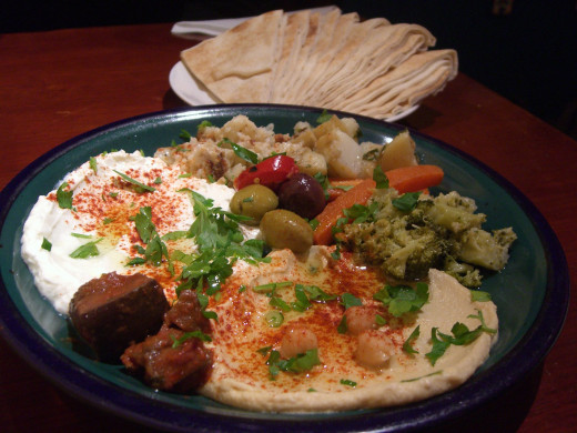 Hummus; a paste consists of garlic, chickpeas, olive, lemon juice and salt. Famous in all of the Arab world.