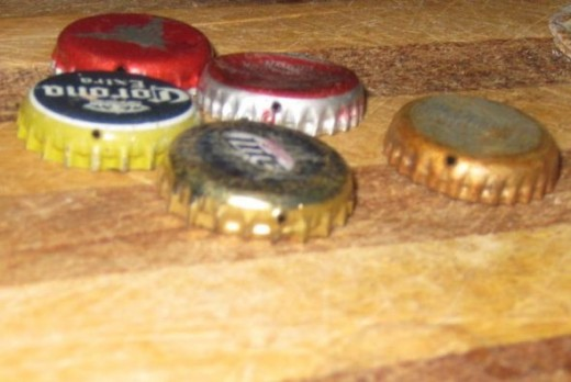 Bottle caps with holes.