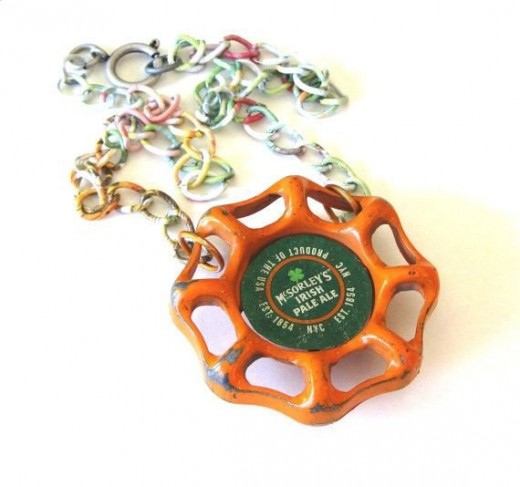 Recycled beer bottle cap and metal faucet handle necklace by SassyBelleWares on Etsy. See link below.