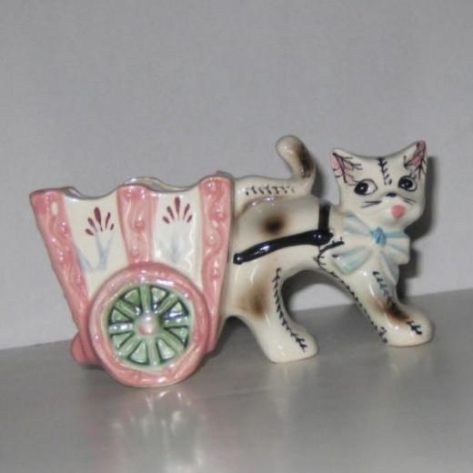 Cat pulling cart.