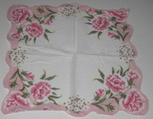 White handkerchief with carnation flowers printed on the hankie.