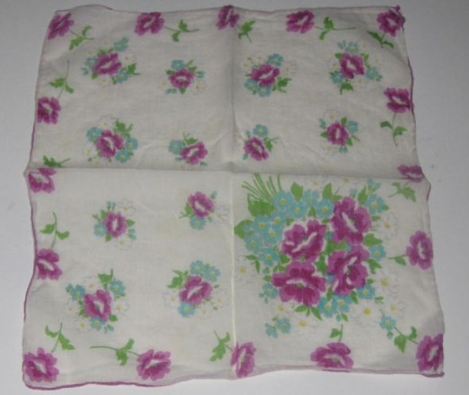 Violets printed on white hankie.