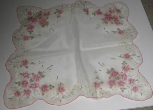 Printed hankie with scalloped edges.