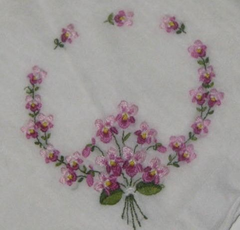 Embroidered violets on a vintage handkerchief.