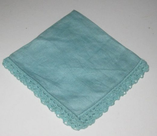 Green hankie with green embroidery.