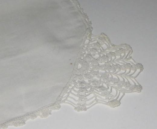 White on white, fan corner embroidery.