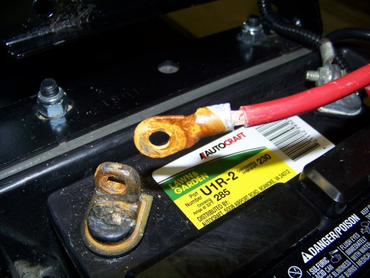 On my Craftsman Lawn Tractor, the battery is installed under the seat.