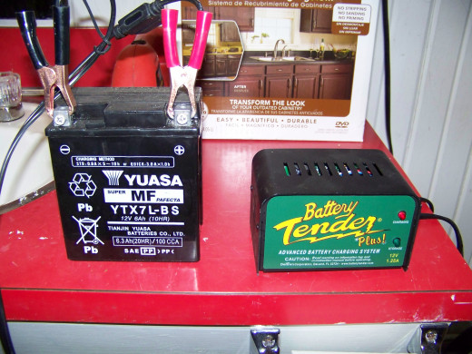 I keep my CBR250R battery in our nice warm basement over the winter. I recharge the battery on a weekly basis using my Battery Tender.
