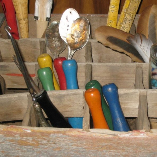 I added toy wooden bowling pins, feathers, marbles, rulers, fountain pens, stamped spoons, and more in my soda crate.