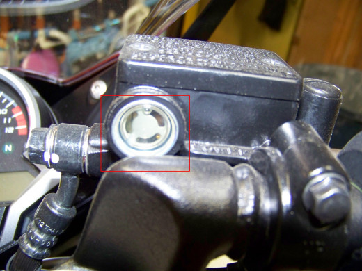Front Brake Fluid Reservoir is located on right handle bar. Check when CBR250R is upright, it should be above the LWR mark.