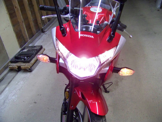 Turn the ignition switch to the On position but do not start CBR250R. Side marker lights and headlight should illuminate. Check front turn signals.