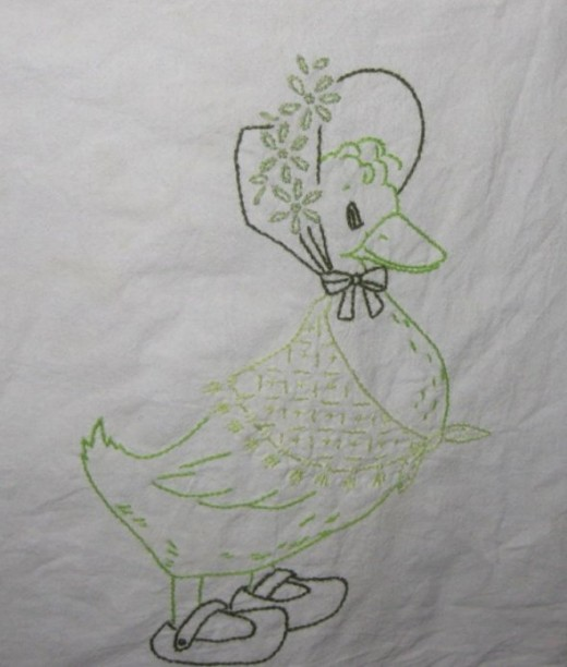 Vintage tea towel with embroidered duck.All photos here by Peggy Hazelwood.