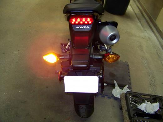 Check left rear turn signal.