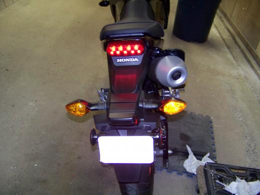 Check right rear turn signal.