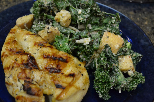 You can prepare an entire meal on an indoor grill pan, like this grilled chicken breast served with grilled kale Caesar salad.