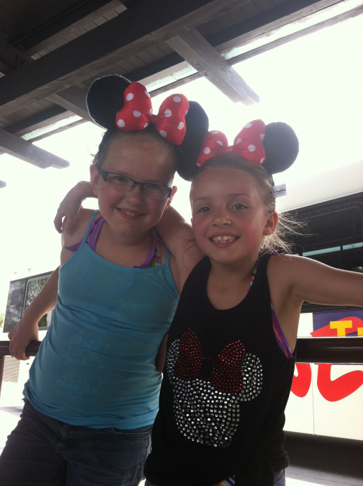 My daughter and niece wearing their brand new Minnie Mouse ears in line at Hollywood Studios. I also had my ears on, but I was the picture taker.