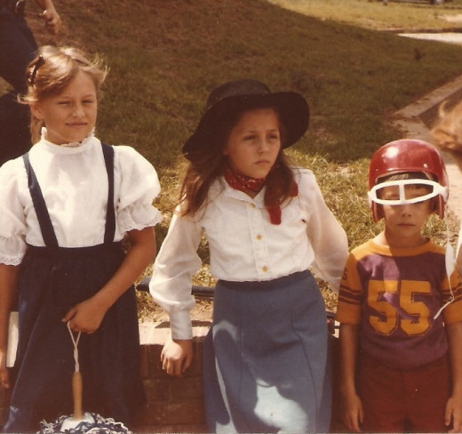 Yep - that's me in the middle as Annie Oakley for Halloween one year. (You can see my rifle in the grass behind me.)