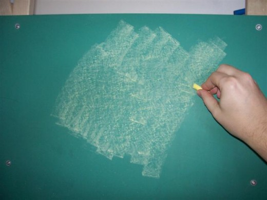 Take the edge of a piece of chalk and cover the entire board