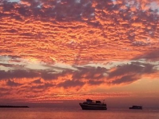 Dimpled Pink Sky at Sunset with Boat