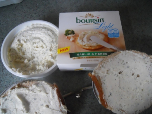 Liberally spread boursin cheese on both pieces of bread.   This will keep the fig juice from seeping and making the bread mushy.