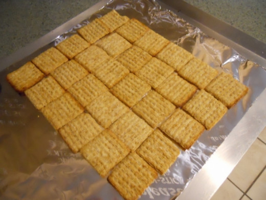 Arrange crackers with edges touching, keeping gaps to a minimum
