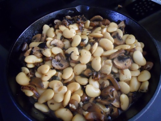 Add beans, nutmeg, salt and pepper to the mixture.   Stir.   Heat until simmering.   About 5 minutes.