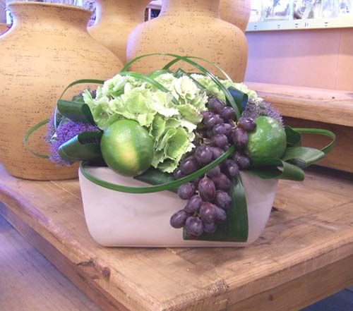 Floral arrangement with hydrangea, limes, grapes, and trachelium