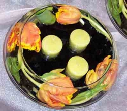 Tulips and scented chartreuse candles in a low Spring centerpiece