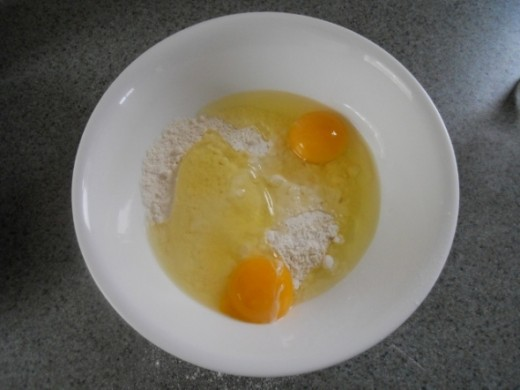 Flour and salt with two eggs added.