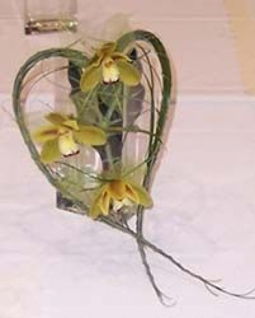 Heart-shaped contemporary bridal bouquet displayed in a vase