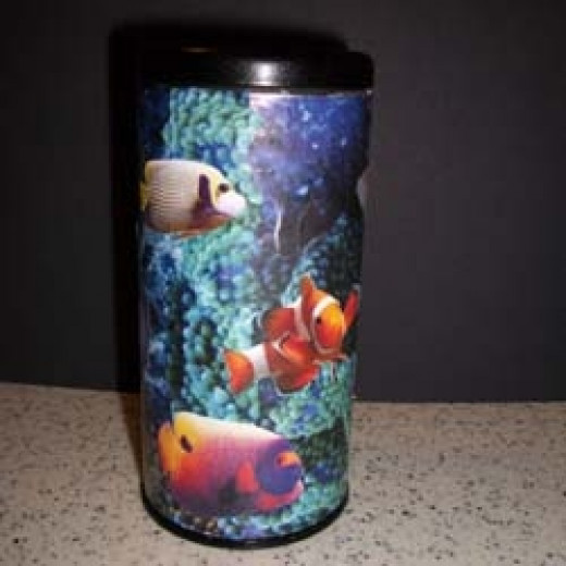 Tea tin covered with vivid images of saltwater fish and corals