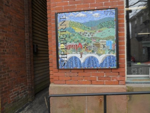 The Shelburne mosaic is on the front of Memorial Hall on Bridge Street