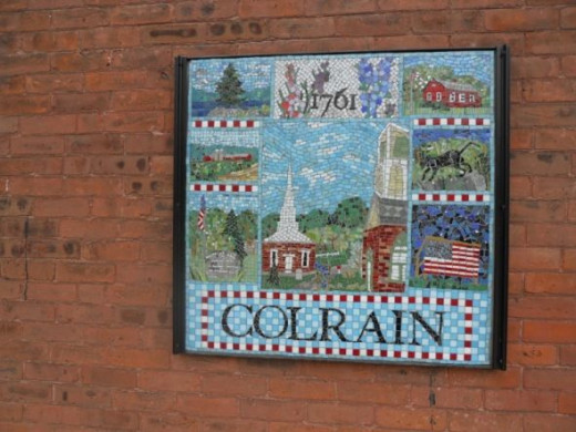 The Colrain mosaic is located at the corner of Main Street and Bridge Street on the Gypsy Apple Restaurant (now closed).