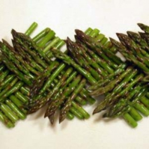 Fresh asparagus woven into a pleasing display.