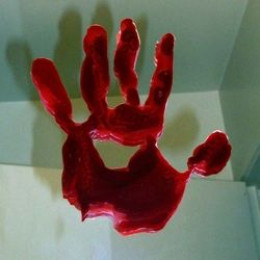 http://kylyssa.hubpages.com/hub/do-it-yourself-bloody-handprint-window-clings
