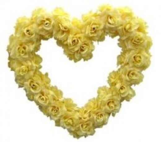 A simple heart wreath made of ivory roses