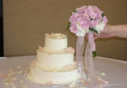 Petals and toss bouquet used to decorate cake