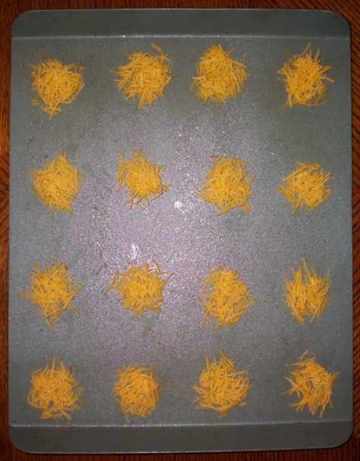 Shredded cheese mounds on baking sheet