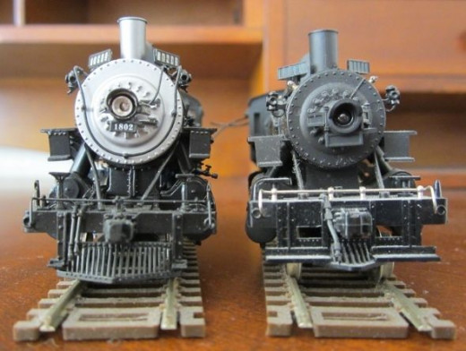 Brass locomotive vs. plastic locomotive